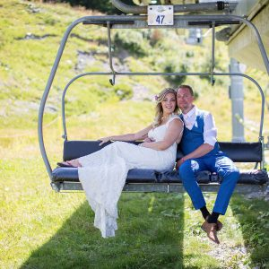 bride and groom on ski lift
